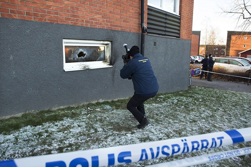 A police officer investigates a suspected arson attack after a fire in a mosque in the southern Swedish town of Eslov on December 29, 2014.  (AFP File Photo)