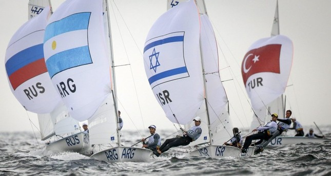 Argentinian 470 Laser class sailors Lucas Calabrese and Juan de la Fuente sail in front of Russian Israel and Turkish crews during the Rio 2016 Olympic Games Sailing events in Guanabara Bay, Rio de Janeiro.