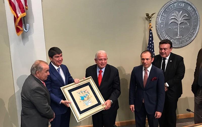 Antalya Mayor Menderes Tu00fcrel (CL), Miami Mayor Tomas Ragalado (C) Turkey's Miami Consul General u00d6zgu00fcr Altan (CR) attend the sister city agreement signing ceremony in Miami, May 24, 2017. (AA Photo)