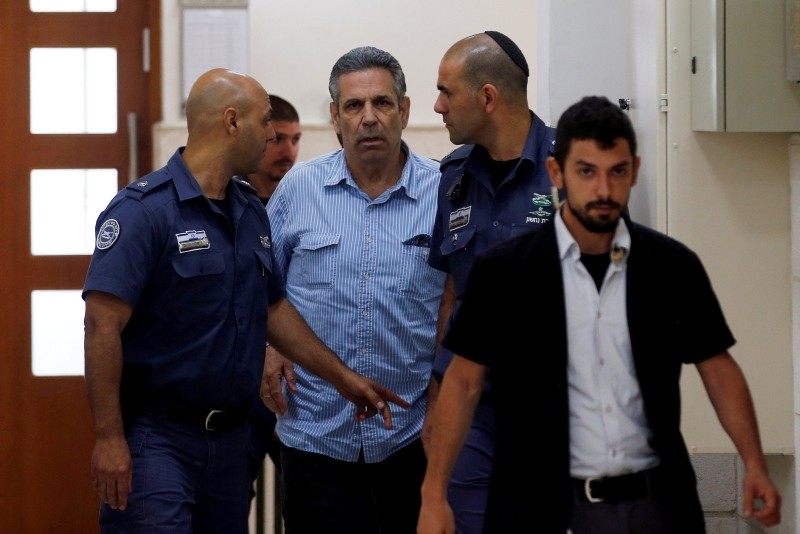 Gonen Segev, a former Israeli cabinet minister indicted on suspicion of spying for Iran, is escorted by prison guards as he arrives to court in Jerusalem, July 5, 2018 (Reuters File Photo)