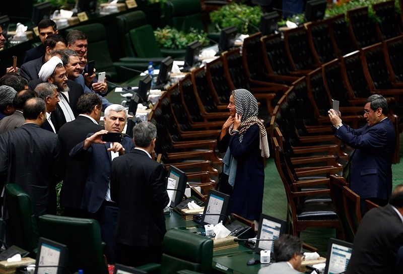 Iranian MPs take souvenir picture with EU foreign policy chief Federica Mogherini at the Iranian parliament after president Hassan Rouhani was sworn-in for his second term of presidency, at the parliament in Tehran, Iran, August 5, 2017. (EPA Photo)