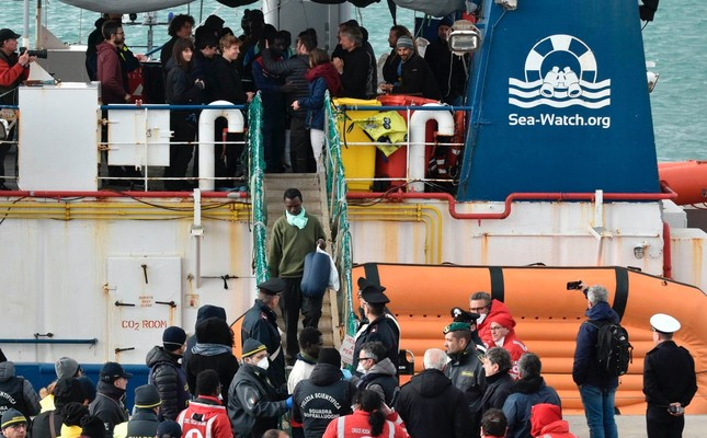 Migrants disembark from the rescue ship Sea-Watch 3 as it docked at the Sicilian port of Catania, Jan. 30, 2019.