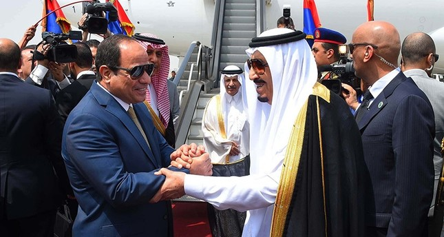 In this Monday, April 11, 2016 file photo provided by the office of the Egyptian Presidency, Egyptian President Abdel-Fattah el-Sissi, left, shakes hands with Saudi Arabia's King Salman before he departs Egypt. (AP Photo)