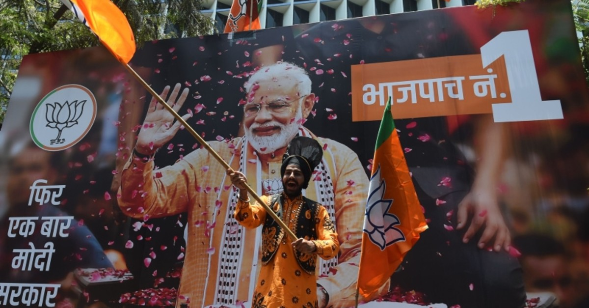 An Indian supporter of Indian Prime Minister Narendra Modi's Bharatiya Janata Party (BJP) celebrates the election results outside the BJP headquarters in Mumbai on May 23, 2019. (AFP Photo)