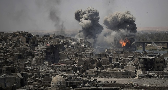 In this July 11, 2017 photo, airstrikes target Daesh positions on the edge of the Old City a day after Iraq's prime minister declared total victory in Mosul, Iraq. (AP Photo)