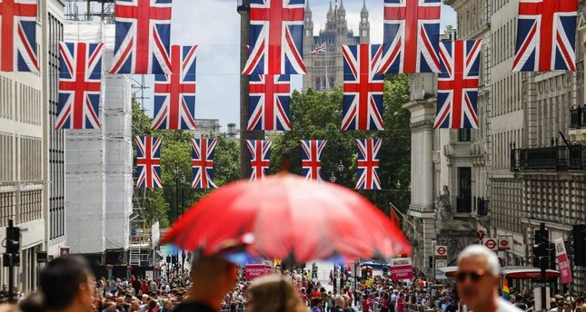 Union flag banners hang across a street near the Houses of Parliament, London, June 25, 2016. AFP Photo