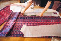 Palestinian fashion designer Natalie Tahhan has been hard at work in her Jerusalem studio, using computers and printed fabric to replace the tedious tasks of manual cross-stitching and...