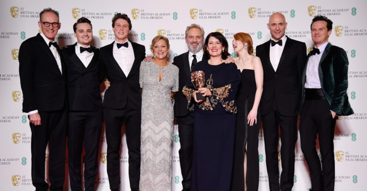 Pippa Harris, Callum McDougall, Sam Mendes, Jayne-Ann Tenggren pose with their award for Best Film for '1917' alongside Dean-Charles Chapman, George MacKay, Mark Strong, Krysty Wilson-Cairns & Andrew Scott at the Royal Albert Hall in London (Reuters)