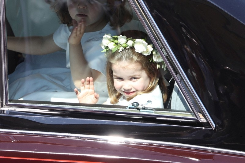 Prince Harry's niece and bridesmaid Princess Charlotte (R) arrives for the wedding ceremony of Britain's Prince Harry, Duke of Sussex and US actress Meghan Markle at St George's Chapel, Windsor Castle, in Windsor, on May 19, 2018.