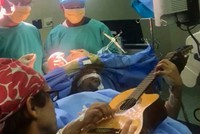 South African musician plays guitar during brain surgery