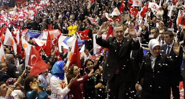 Then Prime Minister Erdoğan, accompanied by his wife Emine Erdoğan, greets supporters as he enters the hall for the third, AK Party congress, Ankara, Oct. 3, 2009.