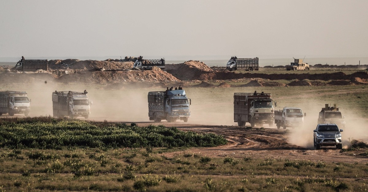 Trucks transporting people evacuated from Daeshu2019s embattled holdout of Baghouz, Feb. 25, 2019.