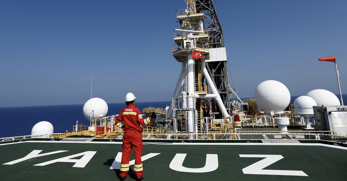 A Turkish Petroleum (TPAO) engineer poses on the helipad of Turkish drilling vessel Yavuz in the Eastern Mediterranean Sea off Cyprus, Aug. 6, 2019. (Reuters Photo)