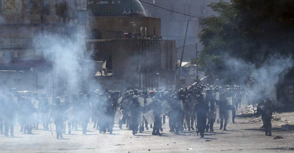 Iraqi riot police fire tear gas to disperse anti-government protesters, Baghdad, Nov. 7, 2019. (AP Photo)