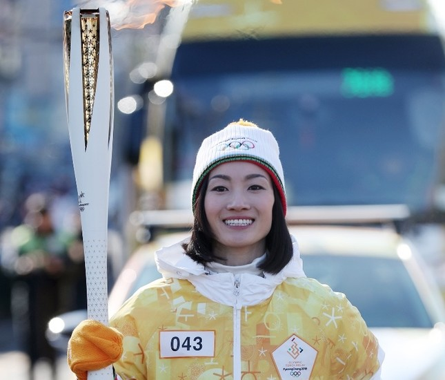 Japanese figure skating gold medalist Shizuka Arakawa carries the torch for the 2018 Pyeongchang Winter Olympics in Incheon, South Korea.