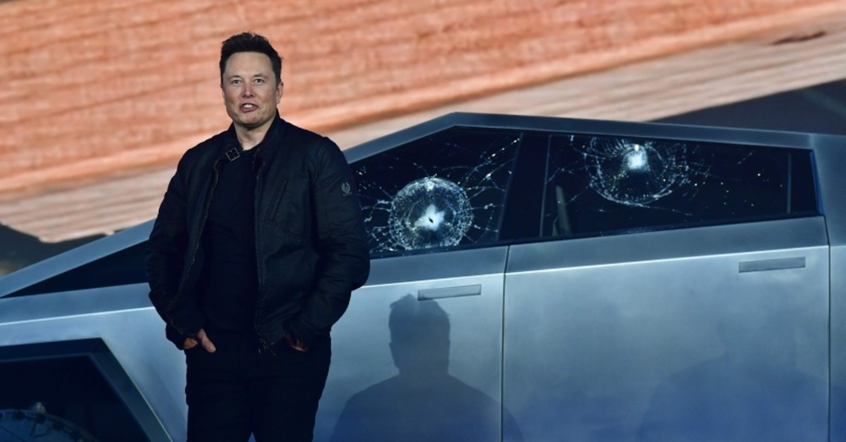 Tesla co-founder and CEO Elon Musk stands in front of the shattered windows of the newly unveiled all-electric battery-powered Tesla's Cybertruck at Tesla Design Center in Hawthorne, California on November 21, 2019.(AFP Photo)