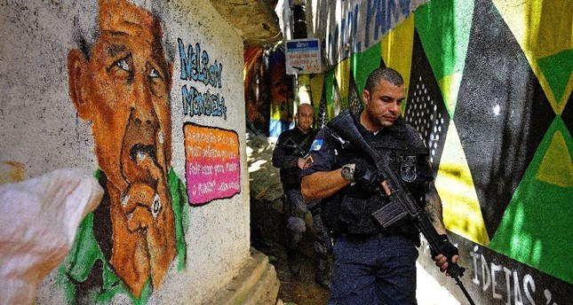 Brazilian police like these on patrol in September have had trouble controlling crime in Rio de Janeiro's vast Rocinha favela. (AFP Photo)