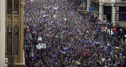 pAt least 160,000 protesters marched Saturday in Barcelona to demand that Spain's conservative-led government increase its efforts to take in refugees from war-torn countries like...