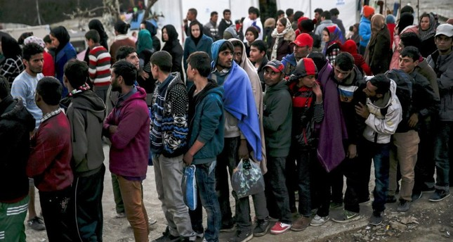 Migrants line up for food at the Moria refugee camp on the Greek island of Lesbos, Nov. 5.