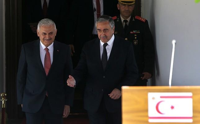 Turkish Prime Minister Binali Yıldırım (L) and Turkish Cypriot leader Mustafa Akıncı leave their meeting following a press conference. (AP Photo)