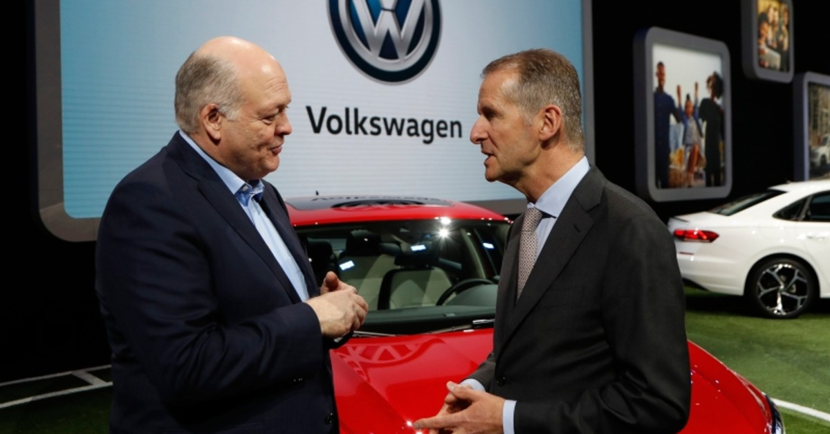 In this Jan. 14, 2019, file photo Ford Motor Co. President and CEO, Jim Hackett, left, meets with Dr. Herbert Diess, CEO of Volkswagen AG, at the North American International Auto Show in Detroit. (AP Photo)