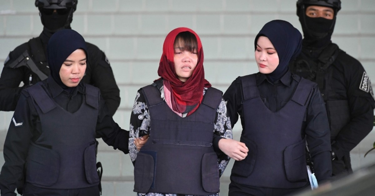 In this photo taken on March 14, 2019, Vietnamese national Doan Thi Huong (C), accused of murdering Kim Jong Nam, the half brother of North Korean leader Kim Jong Un, leaves Shah Alam High Court escorted by police, outside Kuala Lumpur. (AFP Photo)