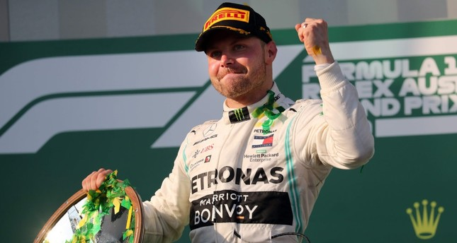 Mercedes' Finnish driver Valtteri Bottas celebrates on the podium after the Formula One Australian Grand Prix in Melbourne on March 17, 2019.