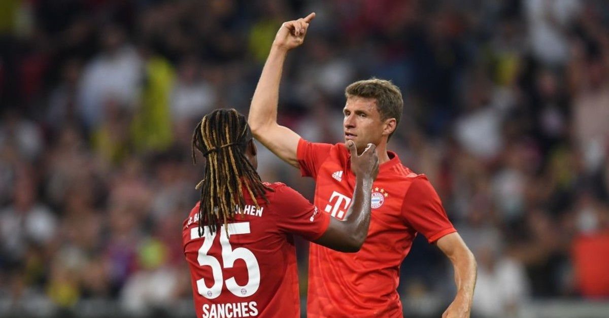 Thomas Mueller (R) and Renato Sanches (L) react after the second goal for Munich, July 30, 2019.
