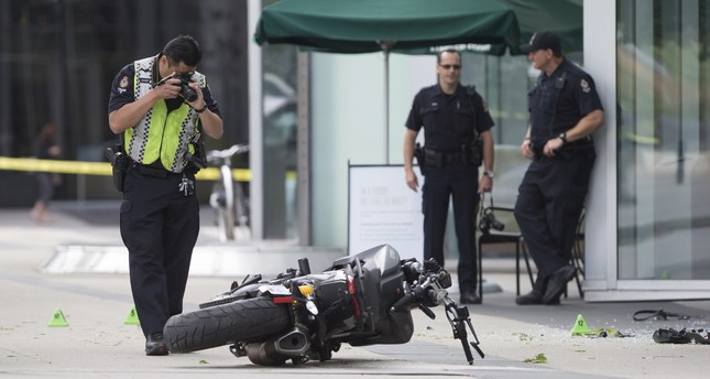 A police officer photographs a motorcycle after a female stunt driver working on the movie Deadpool 2 died after a crash on set on Aug. 14, 2017. (AP Photo)