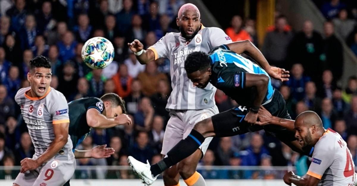 Club Brugge's Nigerian forward David Chidozie Okereke (2R) heads the ball next to Galatasaray's Dutch forward Ryan Babel (C) and Galatasaray's Colombian forward Radamel Falcao (L). (AFP Photo)