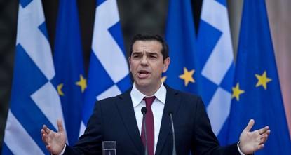 Tsipras wears tie as Greece sings deal ending bailout