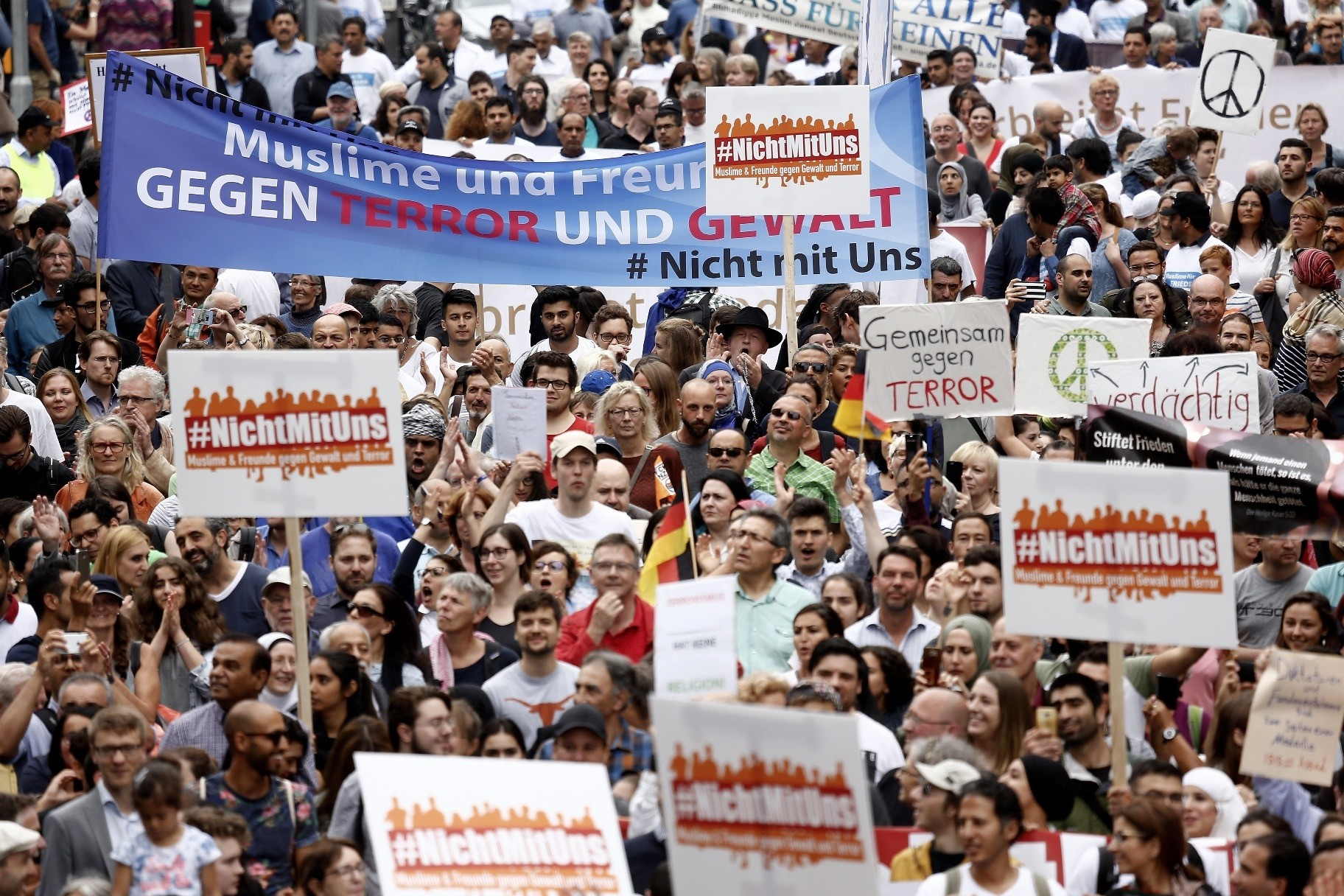 Participants carry a banner reading u201cMuslims and Friends against Terror and Violenceu201d as they take part u201cThe Not With Usu201d rally against the rising anti-Islam sentiment and extremism in Cologne, Germany, June 17.