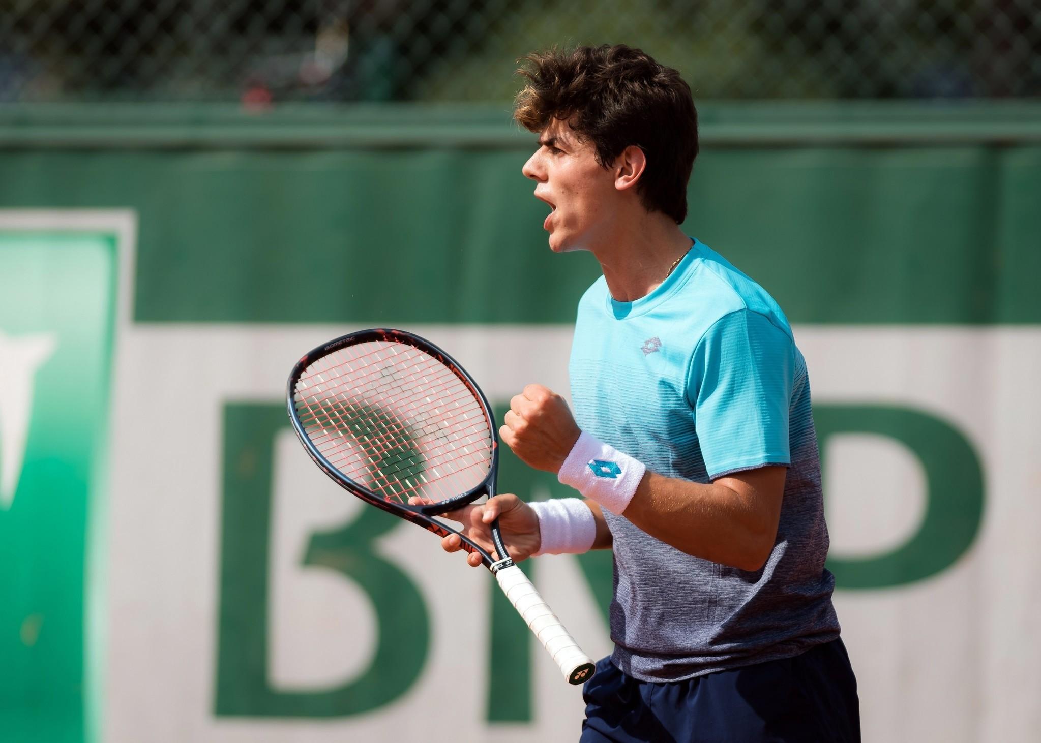 Turkeyu2019s Yanku0131 Erel celebrates after winning the boysu2019 doubles Wimbledon title Sunday.