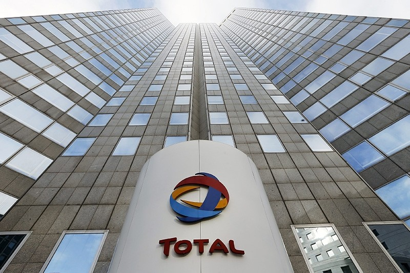 In tjhis Feb.5, 2013 file photo, the logo of the French oil giant Total SA is seen at the entrance of the company headquarters in the La Defense business district, west of Paris. (AP Photo)