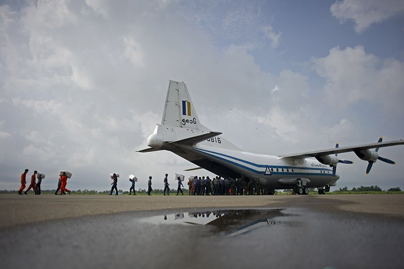 This file photo taken on August 5, 2015 shows a Myanmar Air Force Shaanxi Y-8 transport aircraft being unloaded at Sittwe airport in Rakhine state. (AFP Photo)