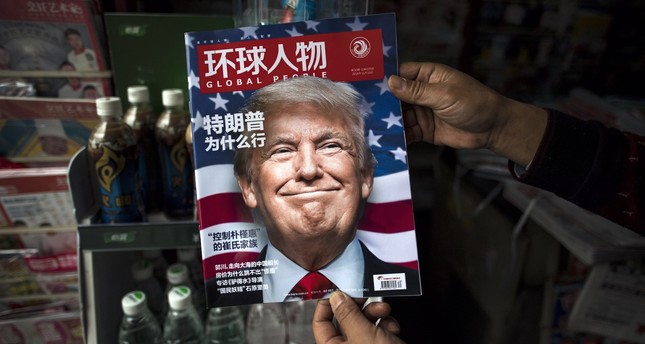 """A copy of the local Chinese magazine Global People with a cover story that translates to """"Why did Trump win"""" at a news stand in Shanghai, China, Nov. 14, 2016."""