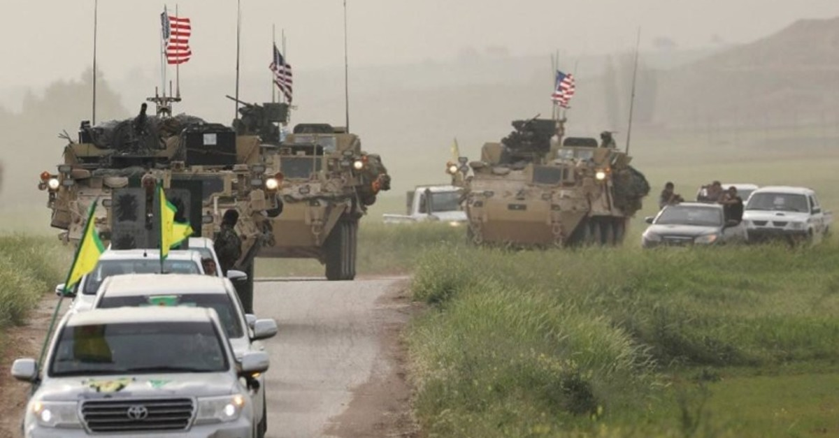 This April 2017 photo shows U.S. tanks and vehicles bearing the YPG flag in the same convoy in northern Syria. (Sabah photo)