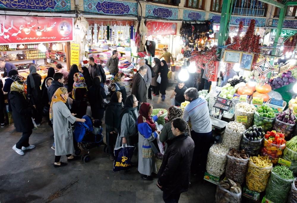 Iranians shop in a bazaar in Tehran, Nov. 5.