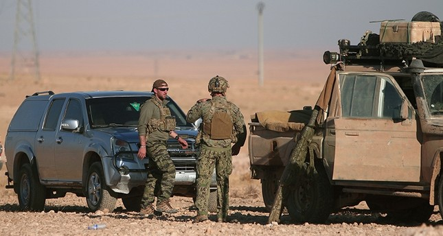 U.S. fighters stand near military vehicles, north of Raqqa city, Syria November 6, 2016 (Reuters Photo)