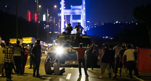Citizens take over a tank controlled by putschists near the Fatih Sultan Mehmet Bridge, Istanbul, July 15, 2016. AFP Photo