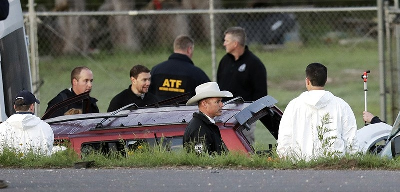 Officials investigate the scene where a suspect in a series of bombing attacks in Austin blew himself up as authorities closed in, Wednesday, March 21, 2018, in Round Rock, Texas. (AP Photo)
