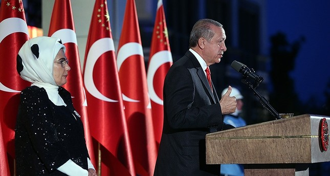 President Recep Tayyip Erdoğan, accompanied by his wife Emine Erdoğan, addresses to the participants of the Victory Day reception at the Beştepe Presidential Complex in Ankara, on Aug. 30, 2017. (AA Photo)