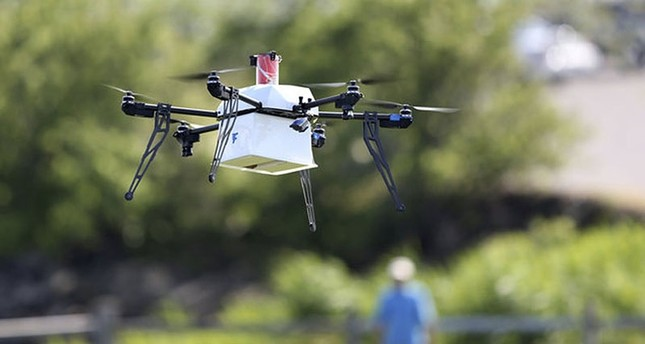 This file photo shows a drone aircraft with a payload of simulated blood, and other medical samples flies during a ship-to-shore delivery simulation Wednesday, June 22, 2016, in Lower Township, N.J. (AP Photo)