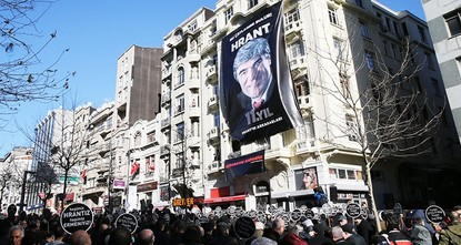 pA large crowd carrying banners We are here, Ahparig [brother] once again gathered at the spot where Hrant Dink, a prominent Turkish Armenian journalist, was killed 11 years ago./p