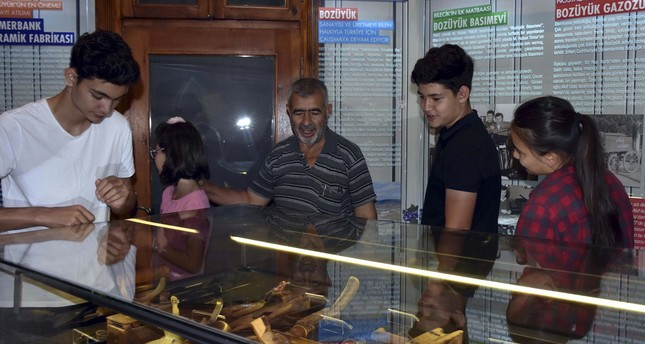 Visitors look at works at the Bozüyük City Museum.