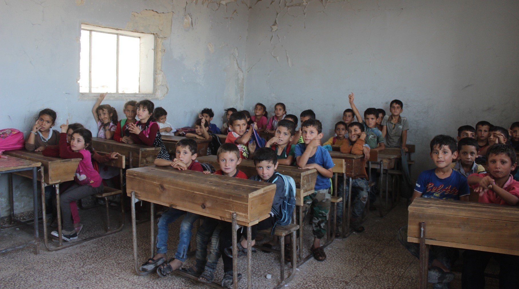 Students in a classroom in Kafr village of Jisr al-Shughour district in the Idlib province of Syria, yesterday.