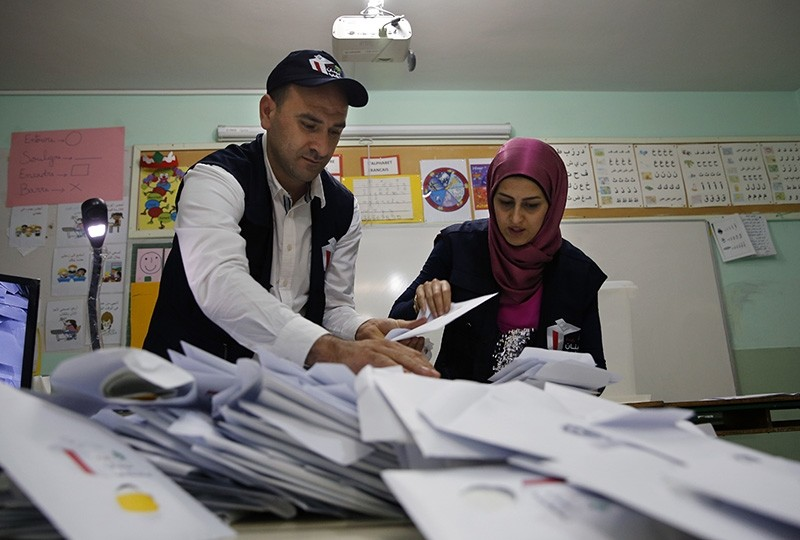 Election officials count ballots shortly after the polling stations closed in Beirut, Lebanon, Sunday, May 6, 2018. (AP Photo)