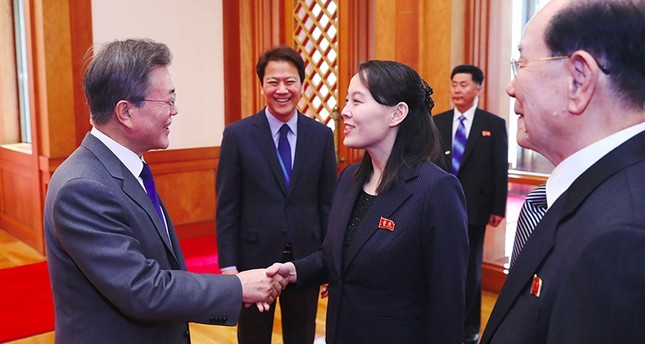 South Korea's President Moon Jae-in (L) greets North Korean leader Kim Jong Un's sister Kim Yo Jong (C) as North Korea's ceremonial head of state Kim Yong Nam (R) looks on before their meeting in Seoul on Feb. 10, 2018. (AFP Photo)