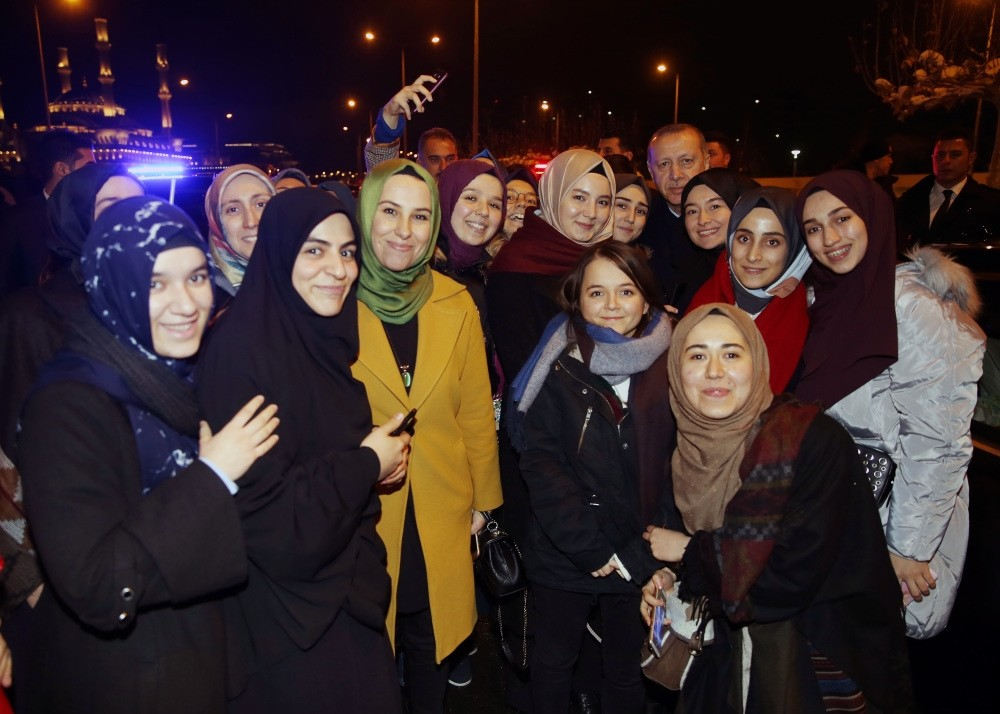 President Recep Tayyip Erdou011fan poses with a group of students during his surprise meeting on Dec. 27 in the capital Ankara.