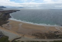 A beach that was swept away more than 30 years ago from a remote island off the west coast of Ireland has reappeared after thousands of tons of sand were deposited on top of the rocky...